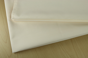 52 X 120 ROYAL CREST 100%  POLYESTER TABLE TOPS - LIGHT IVORY - CARTON PACKED 3DZ